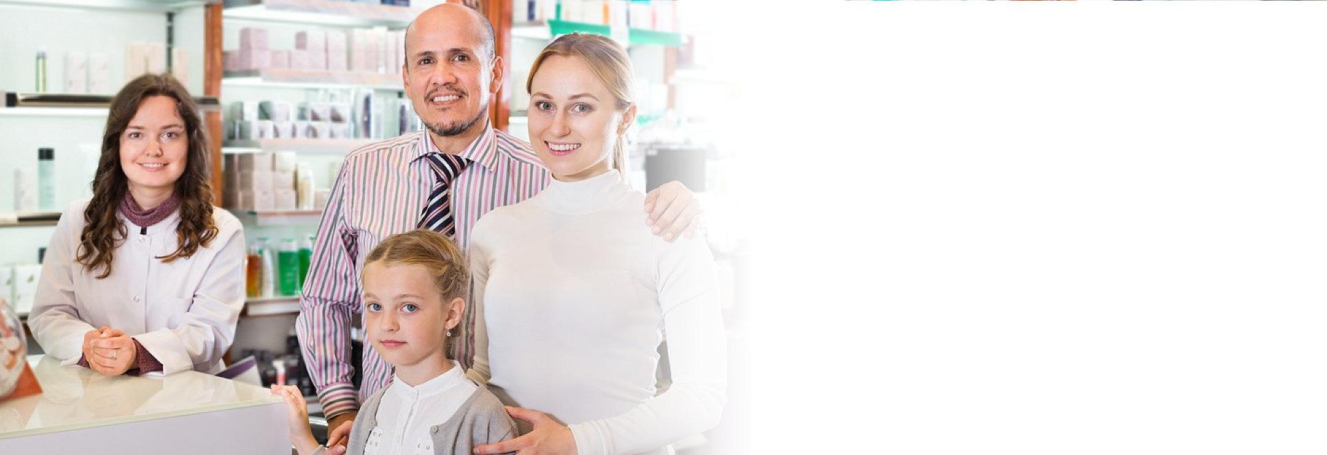 portrait of four people standing in a pharmacy